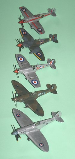 Five assorted Spitfires, echelon starboard